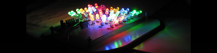 A beautiful array of colored LEDs aimed in all directions on a dark, reflective background